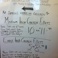 Was this butcher's 'chicken breasts' sign written by a teenage boy?