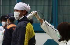 Fukushima workers pulled from reactor after smoke rises
