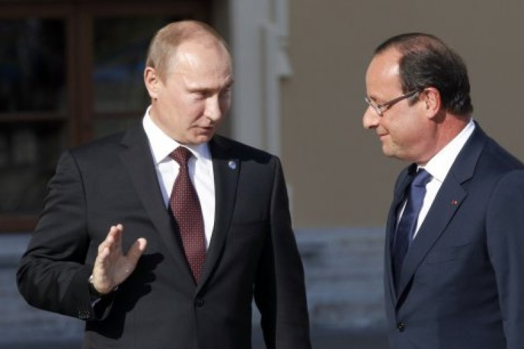 Russia's President Vladimir Putin with French President Francois Hollande at the Konstantin Palace in St. Petersburg.