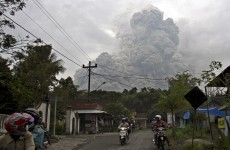 Residents flee after Indonesian volcano spews fresh ash
