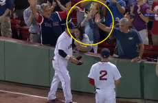 Excited Red Sox fan knocks beer into woman's face after amazing catch
