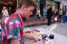 Random man signs autographs at Grafton Street stall