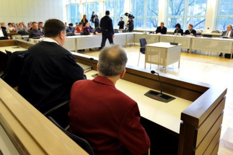 Detlef S., right, sits in the dock of the regional court in Koblenz, western Germany.