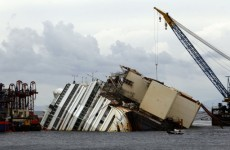 Storm delays huge operation to raise Costa Concordia