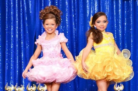 Children participating in a Universal Royalty Pageant.
