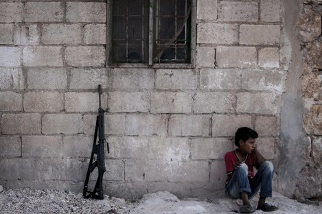 A Syrian child pictured yesterday in a village in the Idlib province.