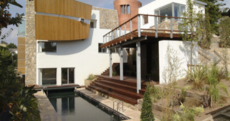 If we're out of recession, should we rent Eddie Irvine's old pad?