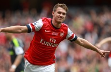 The newly prolific Aaron Ramsey scores as Arsenal go top
