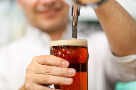 Barman  pulling a pint