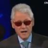 Bill Clinton retaliates with a Bono impression