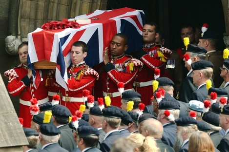 The coffin of murdered Fusilier Lee Rigby is carried from Bury Parish church in Greater Manchester, following his funeral service in July.
