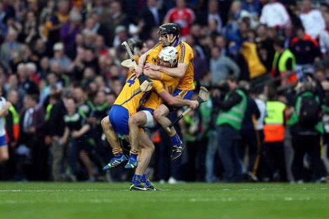 Patrick O'Connor, Cian Dillon and Patrick Donnellan of Clare celebrate at the final whistle.