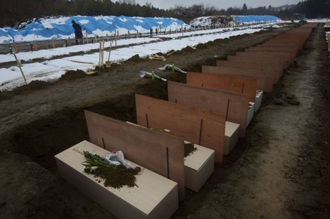 Coffins are lined up at a mass grave site in Higashimatsushima, Japan, today.