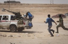 Rebel advance on Gaddafi's hometown checked by pro-government forces
