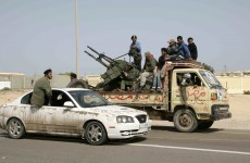 Libya's foreign minister arrives in UK as rebels retreat