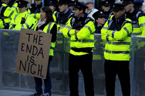 A protester with Garda outside Leinster House earlier.