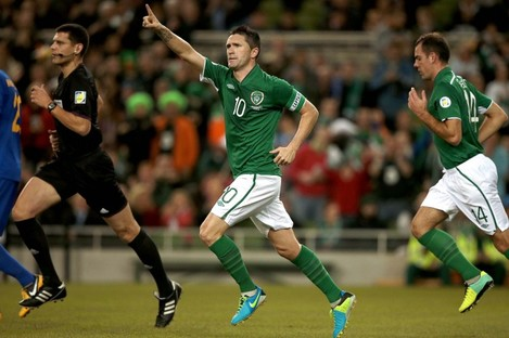 Keane celebrates scoring his 61st senior international goal.