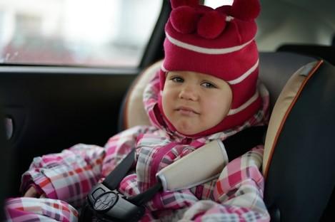 Child in car seat.