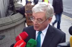 Tánaiste and Howlin insist: James Reilly is doing a very good job