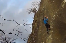 Free-climber plummets off rock face, dusts himself down and strolls away