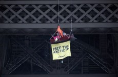 Greenpeace activist suspends from Eiffel Tower in protest