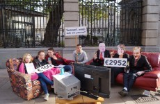 Students protest cuts to social welfare by eating beans on a couch at Leinster House