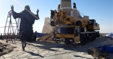 Armed groups hold their fire as giant bronze Jesus statue is erected on top of Syrian mountain