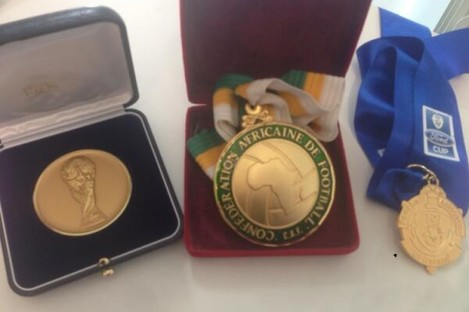 The three medals donated to the fund.