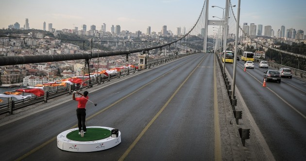Tiger Woods hit a golf ball from Asia into Europe