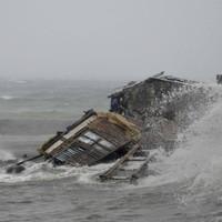 Powerful typhoon sweeps through Philippines, kills three and wrecks homes