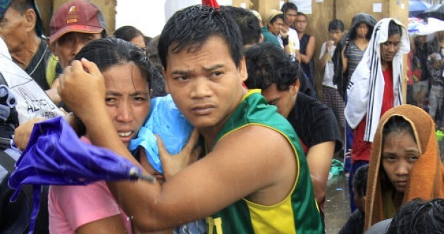 In Pictures: Survivors of Typhoon Haiyan attempt to leave Tacloban