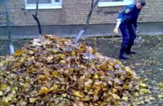 Russian cop creates explosion with a pile of leaves