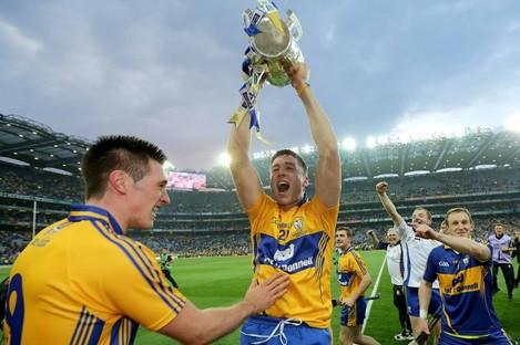 Clare's Conor Ryan and Fergal Lynch celebrate their Liam McCarthy Cup triumph.