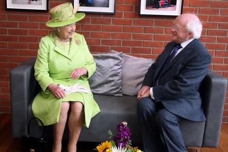 Queen Elizabeth II meets Irish President Michael D. Higgins during a visit to the Lyric Theatre in Belfast last year.