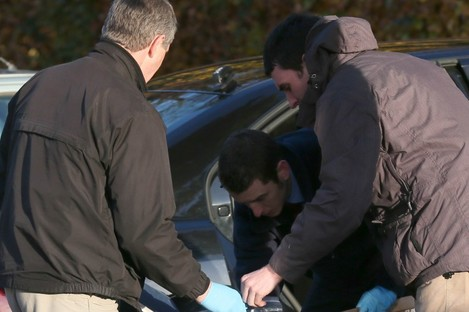 Gardai remove evidence from a partially burnt out car found at Seamount apartments in Montrose today.