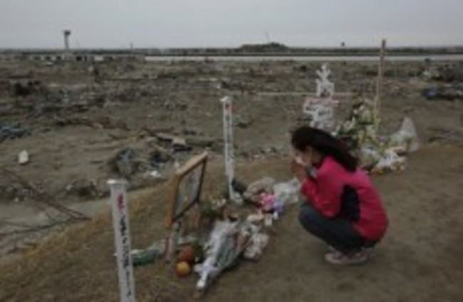 Slideshow: Japan commemorates month anniversary of disaster