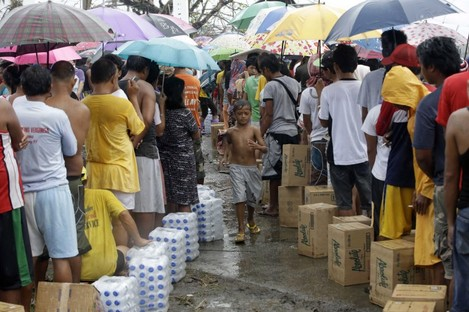 Typhoon survivors line up for food and water