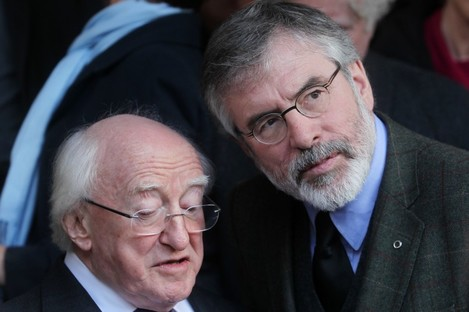 President Michael D Higgins with Sinn Féin's Gerry Adams at a funeral mass for Fr Alex Reid in Dublin this week