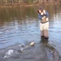 This woman fishing is absolutely terrified of fish