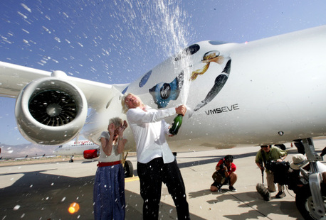 Virgin Galactic founder Richard Branson christens spacecraft White Knight Two 'Eve' after his mother, pictured left