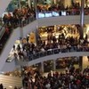 Man arrested for flinging money from 4th floor of shopping centre