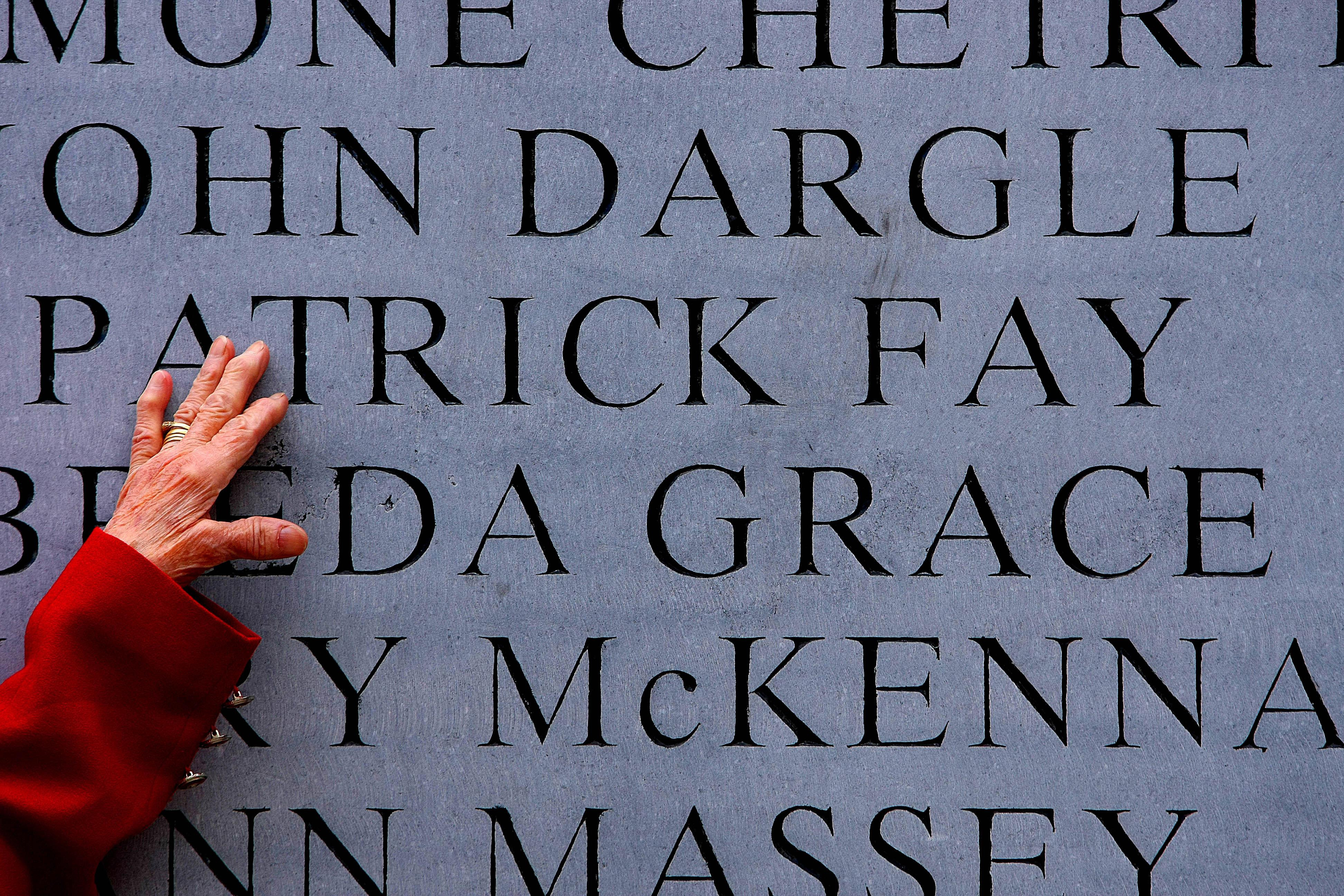 Maura Fay, 85, from Artane touches the name of her late husband Patrick on a memorial to the victims of the 1974 Dublin and Monaghan Bombings.