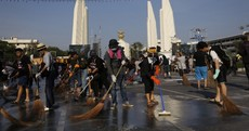 Thai anti-government protesters sweep streets ahead of king's birthday