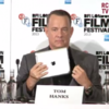 Tom Hanks brilliantly steals an iPad in front of a room of journalists