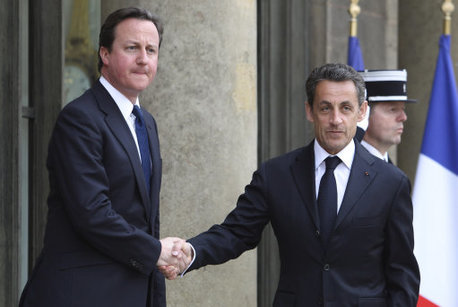 British Prime Minister David Cameron, left, is welcomed by French President Nicolas Sarkozy.