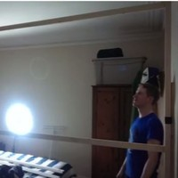 Irish lads prank their housemate by building a wall through his room