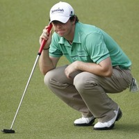McIlroy shoots 64 to move into the lead in Malaysia
