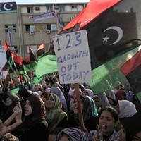 Gaddafi 'using cluster bombs on his own people' in Libya