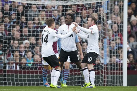 Danny Welbeck celebrates with his United team-mates.