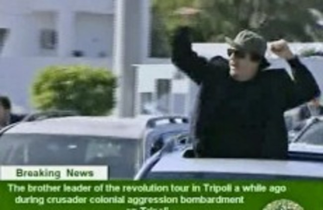 Government forces continue to pound Libyan city as US seeks refuge for Gaddafi